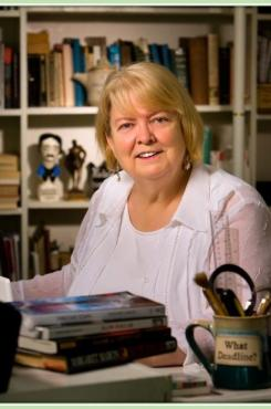 Author Margaret Maron at her desk